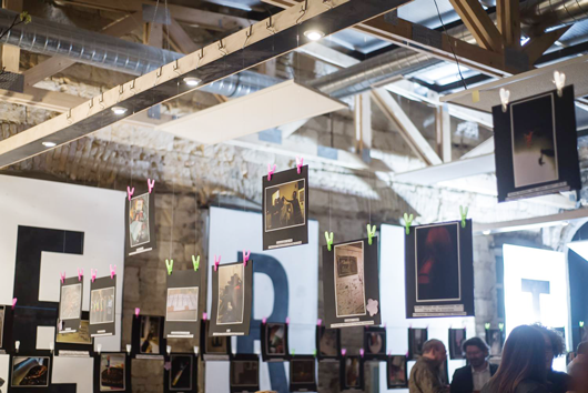 A selection of the photos hanging on display during the public exhibition. Photo taken by Emil Chalhoub.