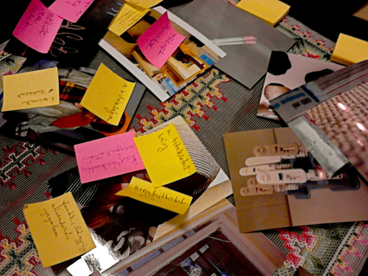 A kaleidoscope of images and post it notes during one of the participatory photography workshops. Photo taken by Camille.